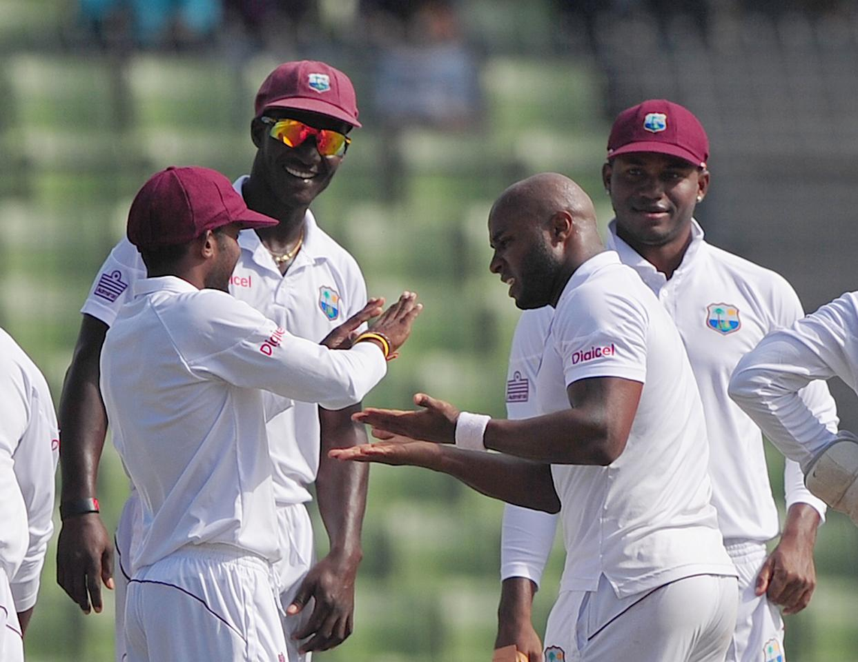 West Indies cricketer Tino Best (2nd R) celebrates with his teammates after the dismissal of Bangladesh cricket captain Mushfiqur Rahim during the fifth day of the first cricket Test match between Bangladesh and The West Indies at the Sher-e-Bangla National Cricket Stadium in Dhaka on November 17, 2012.  AFP PHOTO/ Munir uz ZAMAN