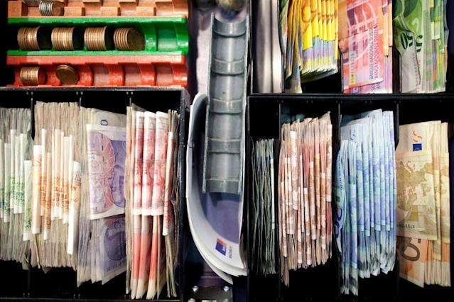 Mixed denomination currency banknotes in a cash register at a Travelex store, operated by Apax Partners LLP, at City airport in London, U.K.. (Photographer: Simon Dawson)