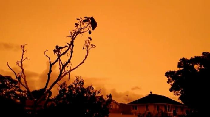 A view of orange skies in Auckland, New Zealand, from smoke plumes caused by bushfires in Australia