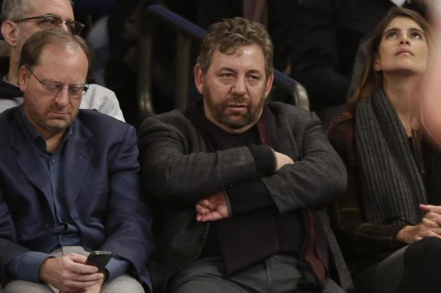 Knicks owner James Dolan (C) watches from the sidelines. (AP)