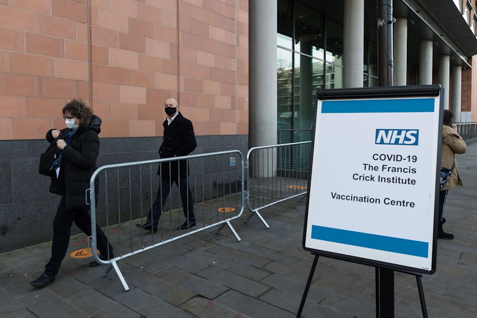 LONDON, UNITED KINGDOM - JANUARY 25, 2021: People leave Francis Crick Institute in London, which begins operating a new Covid-19 vaccination centre from today with a capacity to administer up to 1000 doses a day, seven days a week, on 25 January, 2021 in London, England. The institute is part of further 32 vaccination sites to open this week across England as the NHS continues to accelerate its biggest immunisation program in history, as 6.3 million people already received their first dose across the UK.- PHOTOGRAPH BY Wiktor Szymanowicz / Barcroft Studios / Future Publishing (Photo credit should read Wiktor Szymanowicz/Barcroft Media via Getty Images)