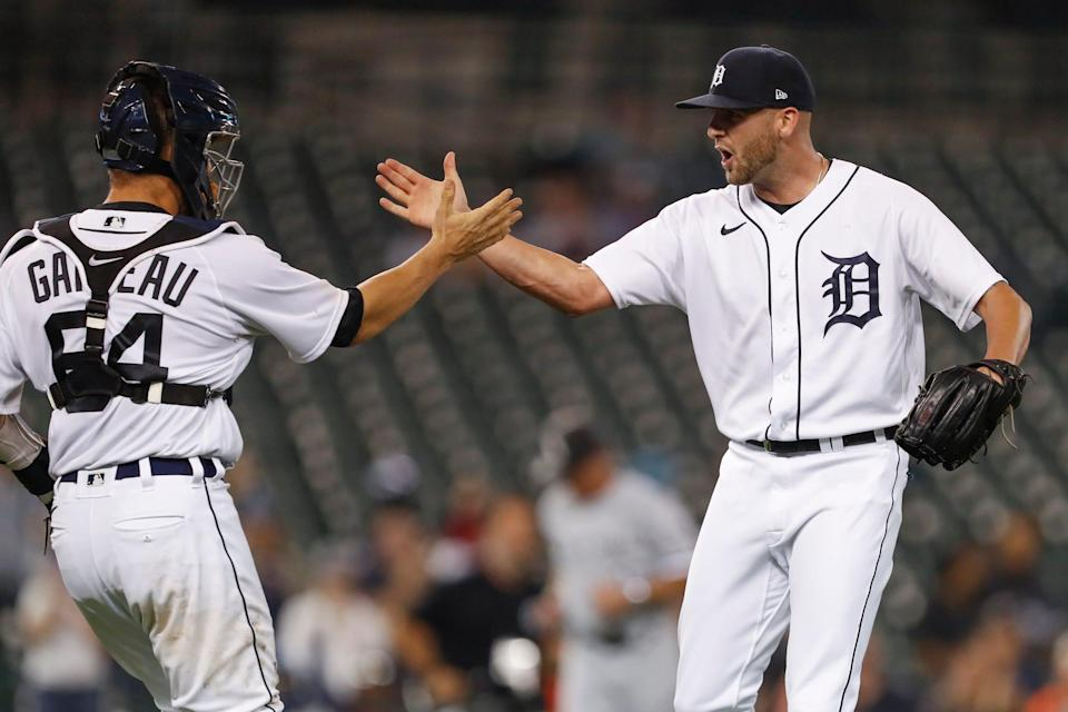 Detroit Tigers relief pitcher Alex Lange (57) celebrates with catcher Dustin Garneau (64) after the game against the Chicago White Sox at Comerica Park on Monday, Sept. 20, 2021.