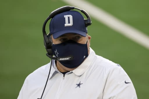 Dallas Cowboys head coach Mike McCarthy talks with a member of his staff on the sideline in the second half of an NFL football game against the San Francisco 49ers in Arlington, Texas, Sunday, Dec. 20, 2020. (AP Photo/Ron Jenkins)