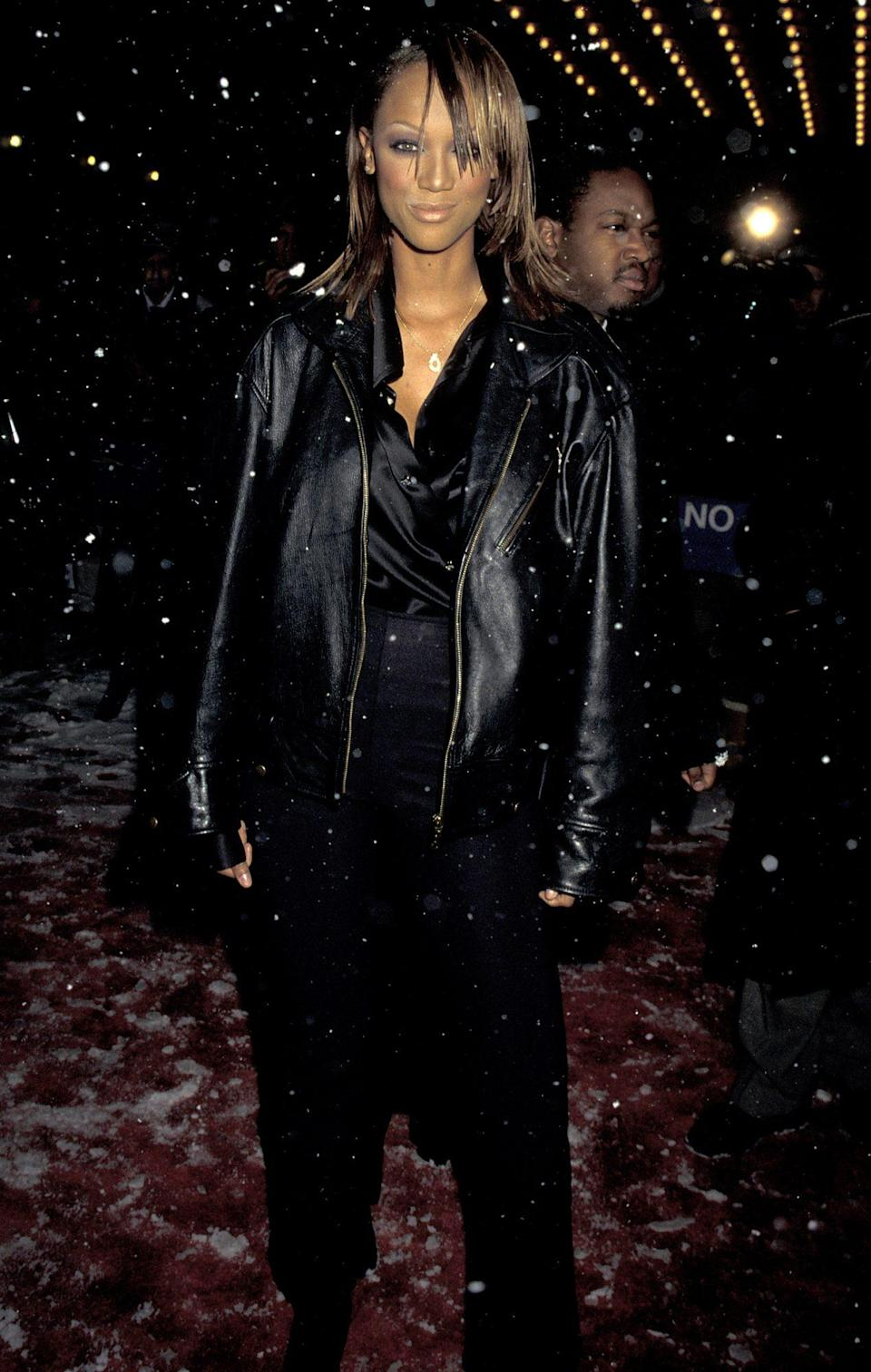 <p>Feast your eyes on the perfect smize — only slightly obscured by '90's side bangs. The supermodel graced the red carpet in an edgy black leather jacket and what looks to be a purple smokey eye. </p>