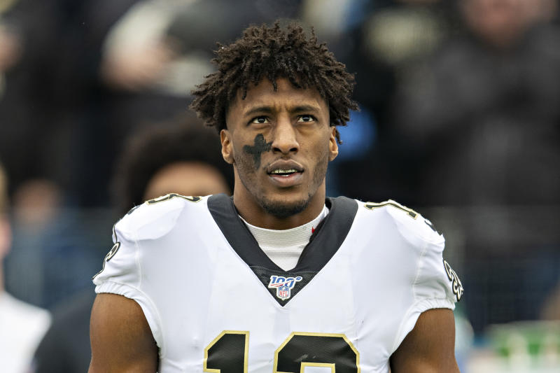 Michael Thomas on the sidelines before a game.