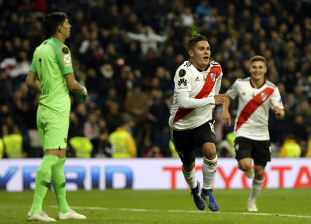 River Plate's Juan Quintero, center, celebrates his team's second goal in overtime against Boca Juniors during the Copa Libertadores final at the Santiago Bernabeu Madrid, Spain on Sunday. (Associated Press)