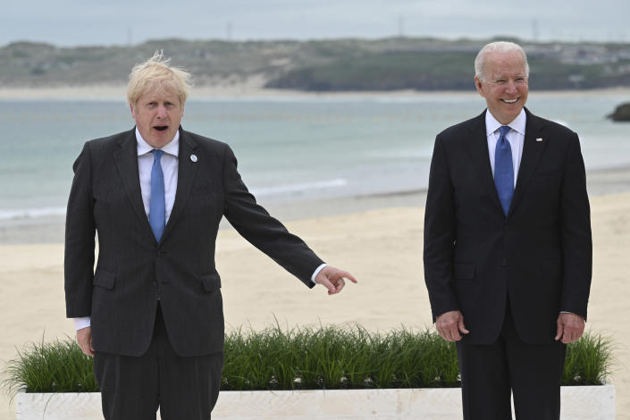 Britain's Prime Minister Boris Johnson, left and US President Joe Biden pose, during the Leaders official welcome and group photo session, during the G7 Summit in Carbis Bay, Cornwall, England, Friday, June 11, 2021. (Leon Neal/Pool Photo via AP)