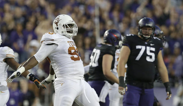 Texas defensive tackle Chris Whaley (96) celebrates after TCU missed a field goal during the first half of an NCAA college football game on Saturday, Oct. 26, 2013, in Fort Worth, Texas. TCU guard John Wooldridge (75). looks on. (AP Photo/LM Otero)