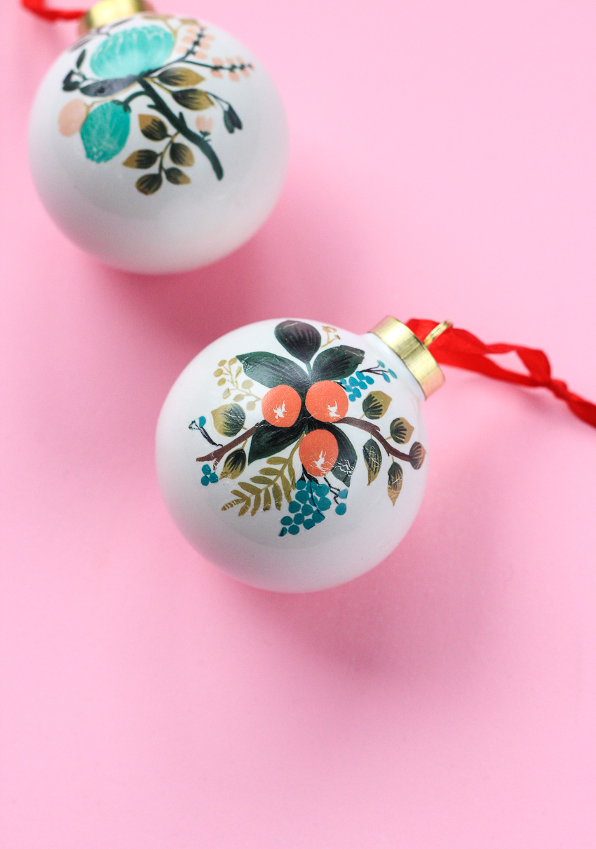 """<p>Yes, these ornaments can be DIY-ed using temporary tattoos—aka they're completely customizable and fun to do. These ornaments take ten minutes or <em>less</em> to complete, so you can deck out your entire Christmas tree in them if you wish.</p><p>Get the tutorial at <a href=""""https://thecraftedlife.com/temporary-tattoo-ornaments/"""" rel=""""nofollow noopener"""" target=""""_blank"""" data-ylk=""""slk:The Crafted Life."""" class=""""link rapid-noclick-resp"""">The Crafted Life.</a></p>"""