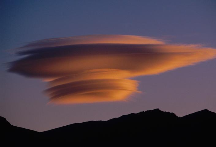 Lenticular cloud over the Sierra Nevada Range, California.