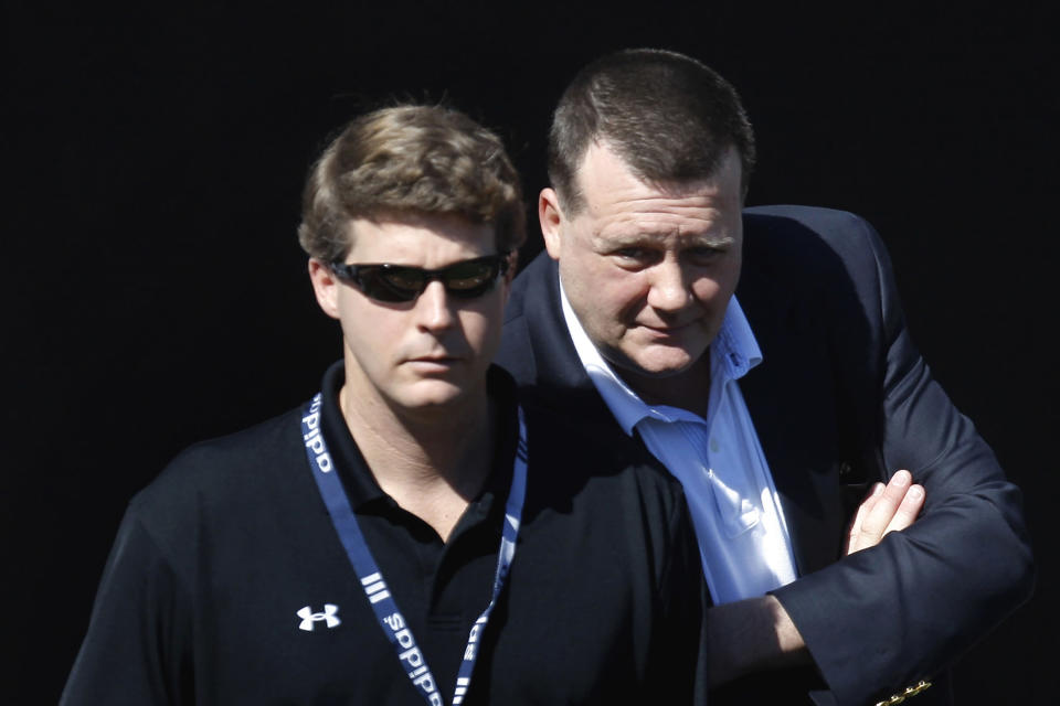 "FILE - In this Feb. 19, 2008, file photo, New York Yankees senior vice president Hank Steinbrenner, right, talks to his brother Hal Steinbrenner while watching action in the bullpen during spring training baseball workouts in Tampa, Fla. Henry ""Hank"" Steinbrenner died Tuesday, April 14, 2020, at his home in Clearwater, Fla. He was 63.(AP Photo/Julie Jacobson, File)"