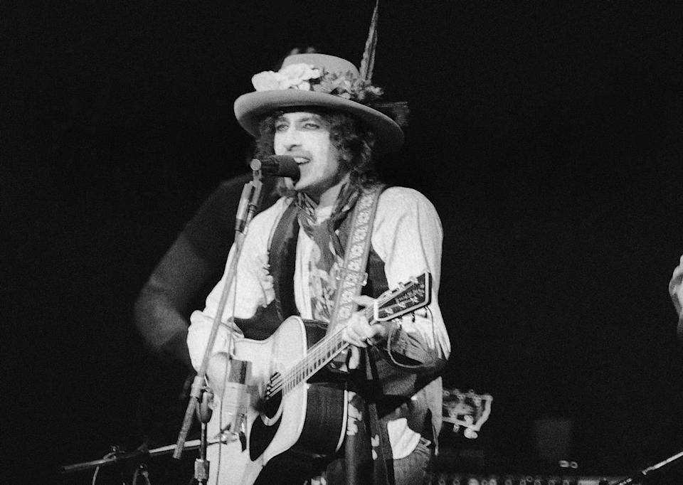 In this Dec. 8, 1975 file photo, Bob Dylan performed before a sold-out crowd in New York's Madison Square Garden. Through constant re-invention, Dylan has remained relevant to music culture for seven decades.