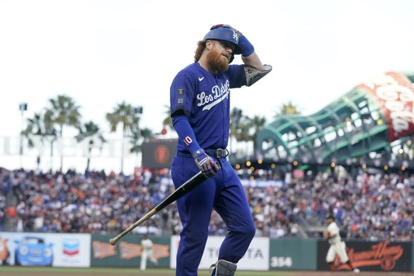 Los Angeles Dodgers' Justin Turner walks to the dugout after striking out against the San Francisco Giants.