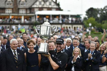 Jul 31, 2016; Springfield, NJ, USA; Jimmy Walker holds up the Wanamaker trophy during the Sunday round of the 2016 PGA Championship golf tournament at Baltusrol GC - Lower Course. Eric Sucar-USA TODAY Sports