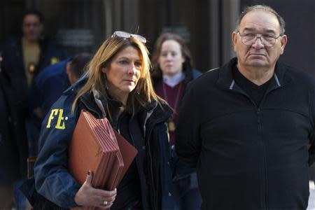 Thomas 'Tommy D' Di Fiore is escorted by FBI agents from their Manhattan offices in New York January 23, 2014. REUTERS/Brendan McDermid