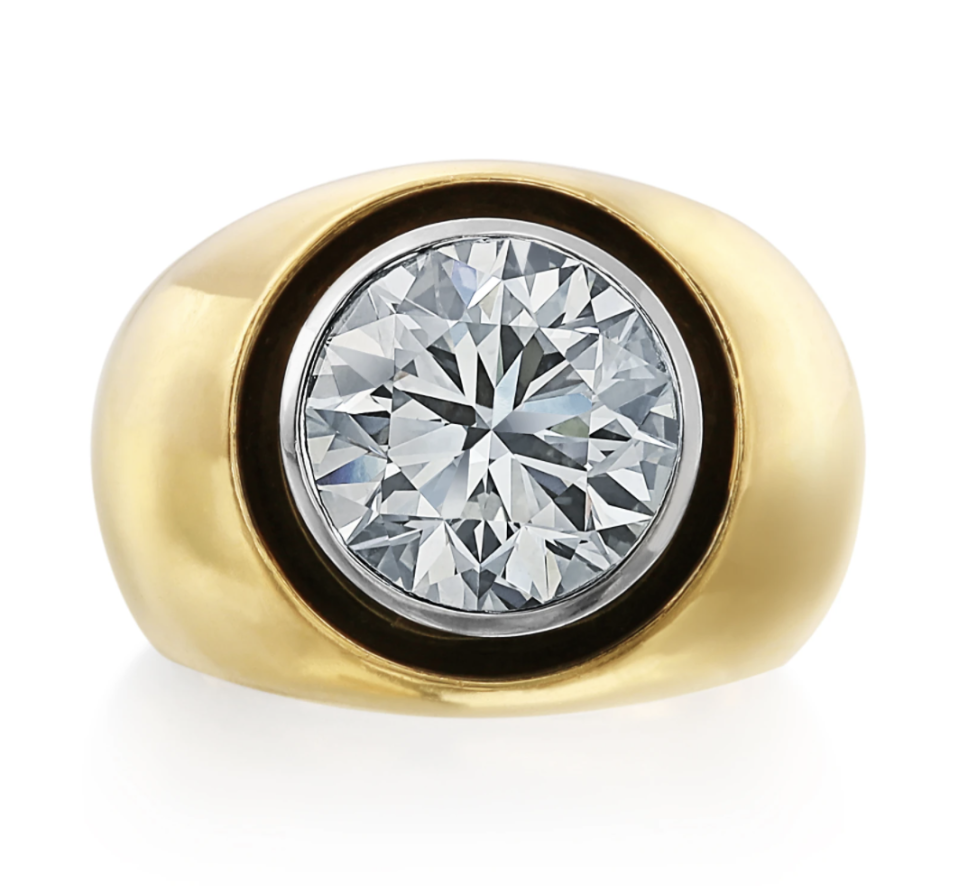 """<p>Nina Runsdorf</p><p><a href=""""https://www.ninarunsdorf.com/products/round-brilliant-cut-diamond-pinky-ring"""" rel=""""nofollow noopener"""" target=""""_blank"""" data-ylk=""""slk:INQUIRE HERE"""" class=""""link rapid-noclick-resp"""">INQUIRE HERE</a></p><p>For a timeless, retro style, Nina Runsdorf created a series of solitaire diamond rings framed in black rhodium in a streamlined, chubby gold setting. Even this 3-carat round diamond is more subtle when set flush with the gold band. </p>"""