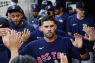 Boston Red Sox' J.D. Martinez celebrates in the dugout after scoring on a Hunter Renfroe base hit during the first inning of the team's baseball game against the Atlanta Braves on Wednesday, June 16, 2021, in Atlanta. (AP Photo/John Bazemore)