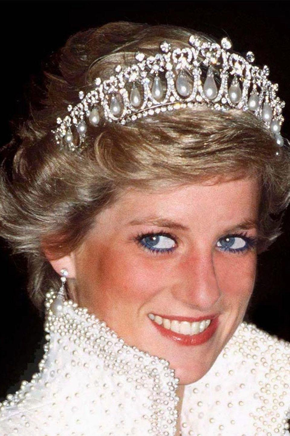 <p>Princess Diana in an ornate tiara from the crown jewels</p>
