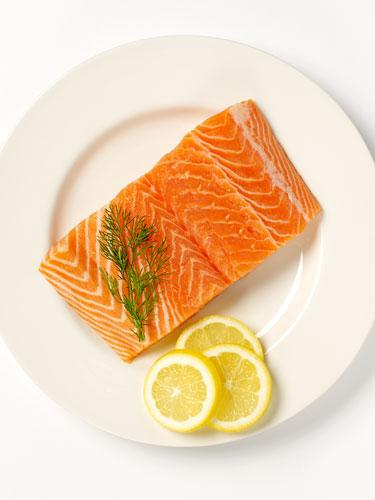 """<div class=""""caption-credit""""> Photo by: COURTESY OF GETTY IMAGES</div><div class=""""caption-title"""">Salmon</div>""""Foods that are rich in omega-3 fatty acids are known to reduce inflammation,"""" says New York-based dermatologist, Dr. Dennis Gross. This is particularly helpful for those who suffer from chronic skin conditions like eczema, as the omega-3s help to maintain a healthy cell membrane and hold in moisture."""