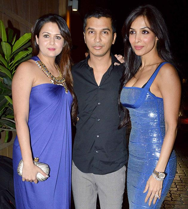 Amrita and Malaika Arora in colour coded blue dresses.