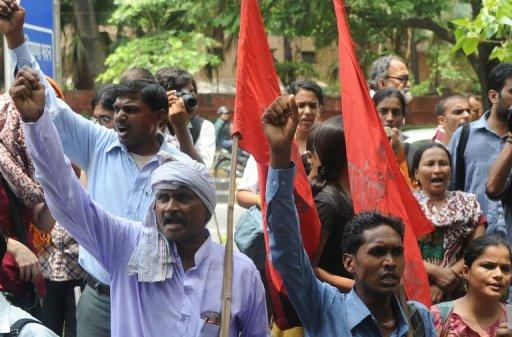 Workers chased Maruti executives with iron bars, destroyed equipment and torched offices in the riot, witnesses said