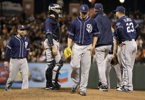 San Diego Padres' Andrew Werner, center, leaves the game against the San Francisco Giants in the fourth inning of a baseball game, Saturday, Sept 22, 2012, in San Francisco. (AP Photo/Ben Margot)