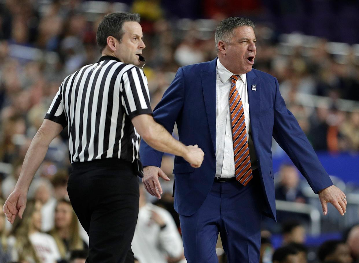 Auburn head coach Bruce Pearl, right, reacts to a call during the first half against Virginia in the semifinals of the Final Four NCAA college basketball tournament, Saturday, April 6, 2019, in Minneapolis. (AP Photo/David J. Phillip)