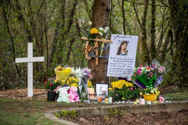 A memorial is pictured on Friday, March 26, 2021, in Greentree Village park in Burnaby, British Columbia, where the body of Marie Cecilia Loreto was found.