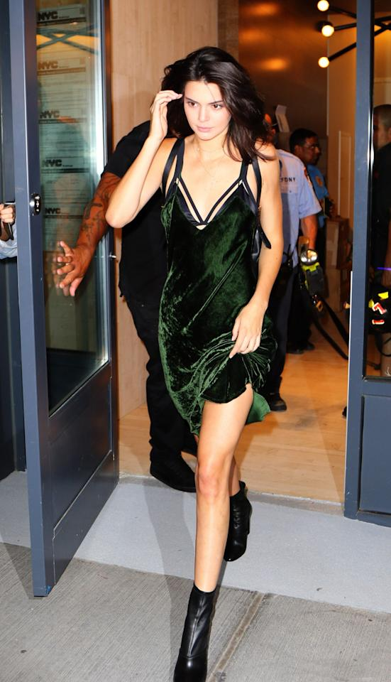 <p>Wearing a bang-on-trend velvet dress, Kendall proved her sartorial prowess while out and about in NYC. [Photo: Rex] </p>