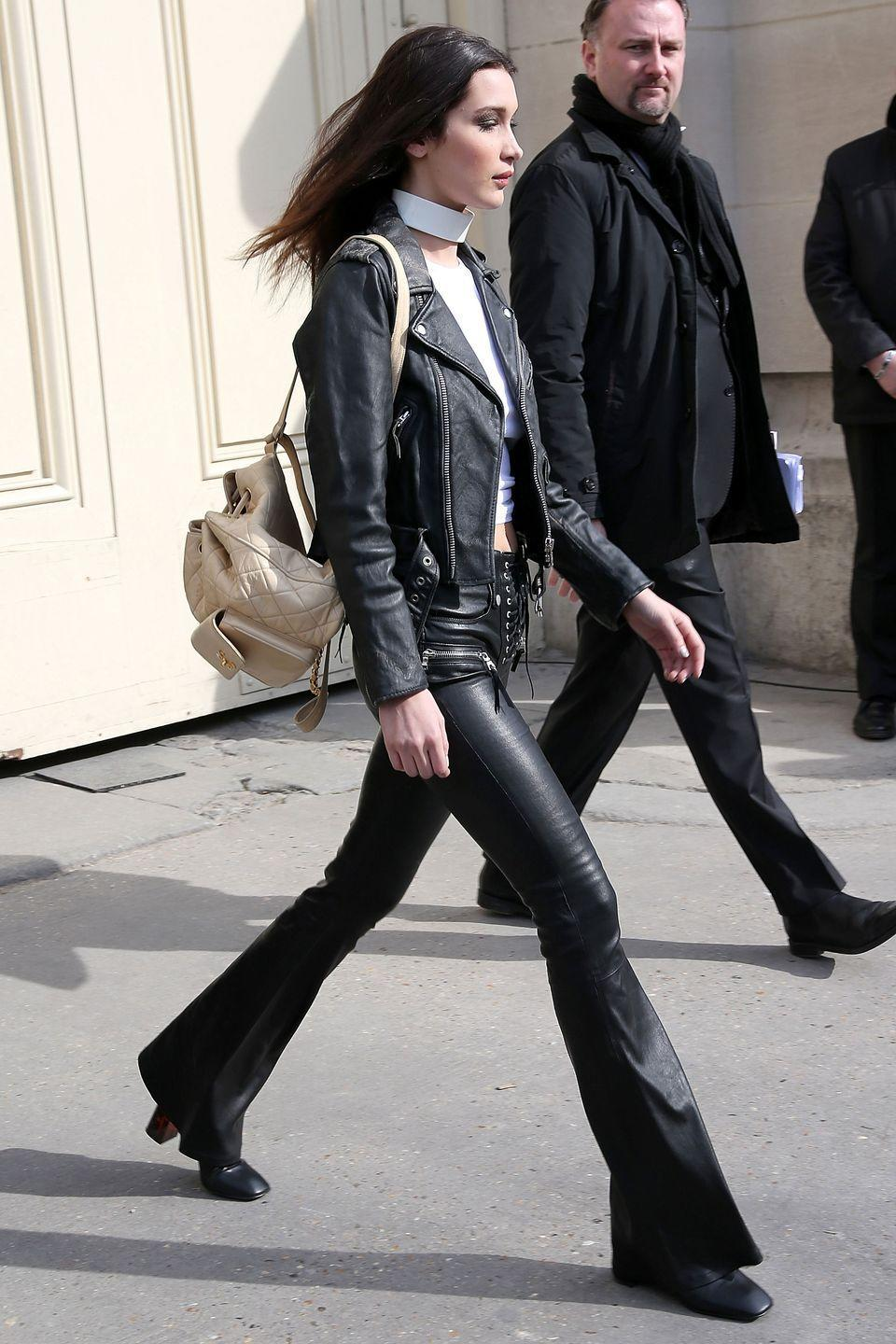 <p>In leather flares, black moto jacket and cream backpack leaving the Chanel show at Paris Fashion week.</p>