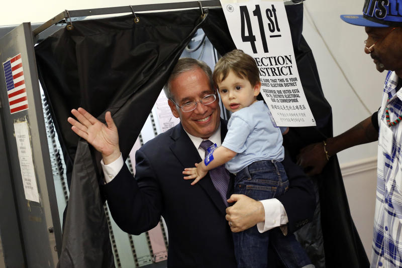 Manhattan Borough President Scott Stringer emerges from a voting booth with his 20-month old son Max after casting his ballot during the primary election, Tuesday, Sept. 10, 2013, in New York. Stringer is running against Ex-Gov. Eliot Spitzer for city comptroller. (AP Photo/Jason DeCrow)