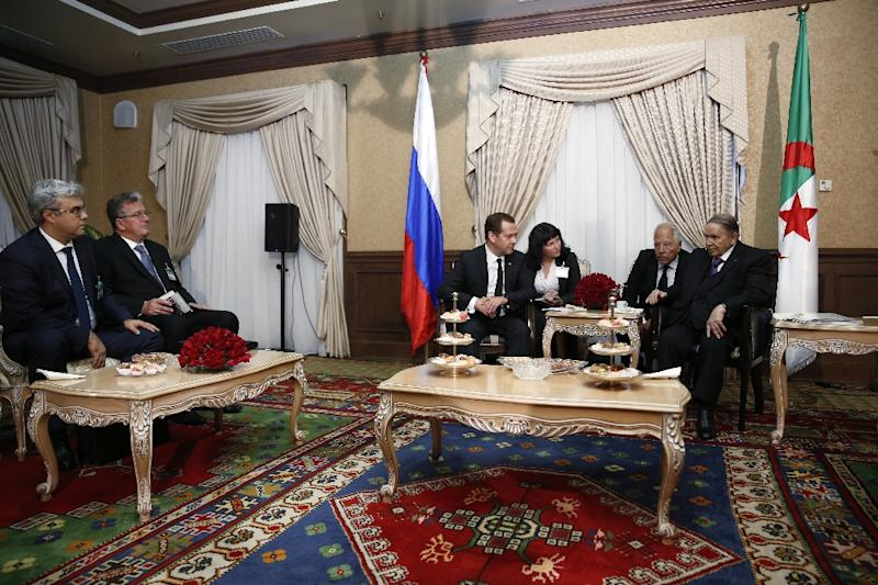 A handout picture from the Sputnik news organisation on October 10, 2017 shows Russian Prime Minister Dmitry Medvedev (C-L) with Algerian President Abdelaziz Bouteflika (R)