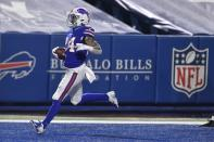 Buffalo Bills' Taron Johnson (24) returns an interception for a touchdown during the second half of an NFL divisional round football game against the Baltimore Ravens Saturday, Jan. 16, 2021, in Orchard Park, N.Y. (AP Photo/Adrian Kraus)