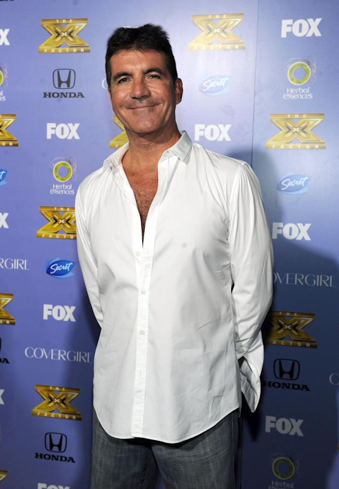 "Simon Cowell arrives at Fox's ""The X Factor"" Season 3 premiere party at Ciccone Restaurant on September 5, 2013 in West Hollywood, California."