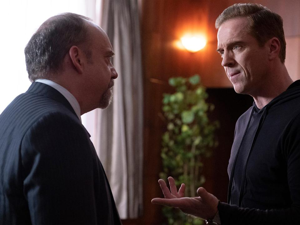 Chuck Rhoades (Paul Giamatti), left, the recently ousted U.S. attorney, and Bobby Axelrod (Damian Lewis) are central antagonists in the high-flying New York financial culture of Showtime's 'Billions.'