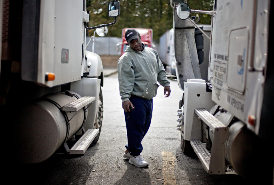 Truck driver pay is surprisingly low, given the need for drivers. (AP Photo/David Goldman)