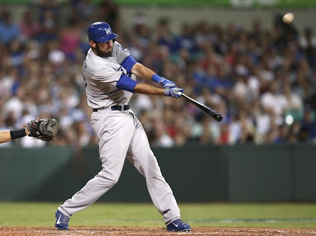 The Los Angeles Dodgers' Scott Van Slyke hits a two-run home run in the Major League Baseball opening game between the Los Angeles Dodgers and Arizona Diamondbacks at the Sydney Cricket ground in Sydney, Saturday, March 22, 2014. (AP Photo/Rick Rycroft)