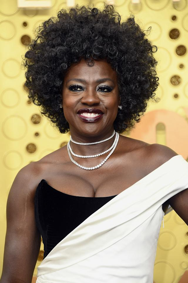 "It's clear Davis is putting <a href=""https://www.glamour.com/story/viola-davis-is-the-new-face-of-loreal-paris?mbid=synd_yahoo_rss"">her new L'Oréal</a> contract to work—just <em>look</em> at those curls, that <a href=""https://shop-links.co/1684922423245572135"" rel=""nofollow"">lip color</a>...honestly, everything."