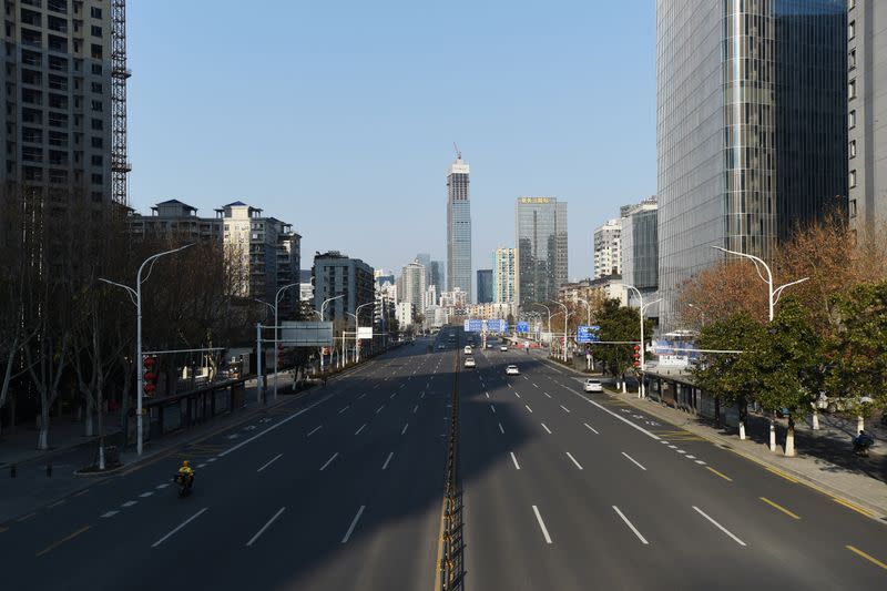 Vehicles travel on a major avenue in Wuhan, the epicentre of the novel coronavirus outbreak