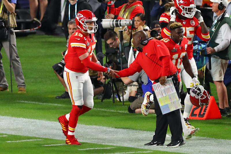 MIAMI GARDENS, FL - FEBRUARY 02: Kansas City Chiefs Quarterback Patrick Mahomes (15) shakes hands with Kansas City Chiefs offensive coordinator Eric Bieniemy after scoring a touchdown during the first quarter of Super Bowl LIV on February 2, 2020 at Hard Rock Stadium in Miami Gardens, FL. (Photo by Rich Graessle/PPI/Icon Sportswire via Getty Images)