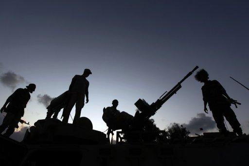 Libyan rebels guard an outpost on the outskirts of Sirte