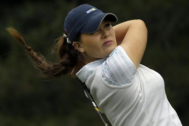 Great Britain and Ireland's Annabelle Dimmock tees off on the third hole during second day of the 38th Curtis Cup amateur golf match against the United States Saturday, June 7, 2014, in St. Louis. (AP Photo/Jeff Roberson)