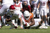 Oklahoma quarterback Spencer Rattler (7) is sacked by Texas defensive lineman Alfred Collins (95) during the first half of an NCAA college football game at the Cotton Bowl, Saturday, Oct. 9, 2021, in Dallas. (AP Photo/Jeffrey McWhorter)