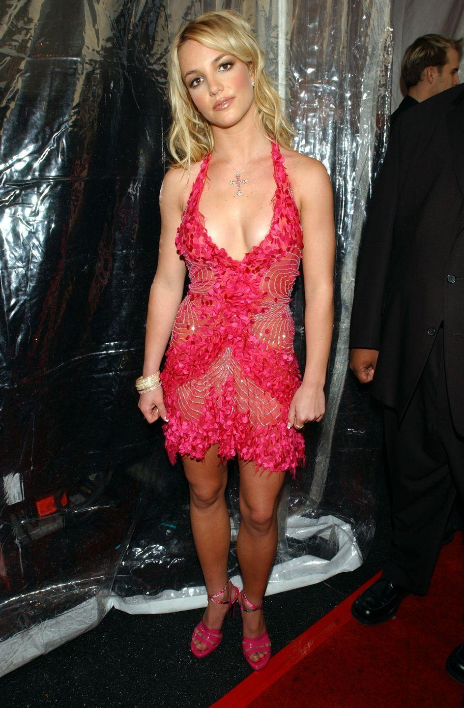 <p>Britney Spears rocks a low-cut red dress at the 29th Annual American Music Awards on January 9, 2002.</p>