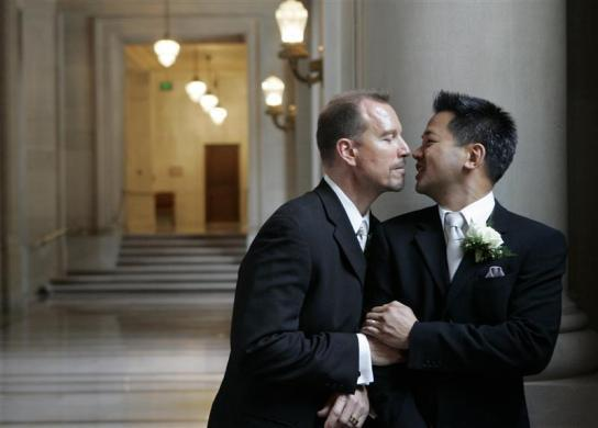 Same-sex couple Stuart Hata (R) and Mark Cadena share a private moment in City Hall after their wedding ceremony in San Francisco, California November 3, 2008.
