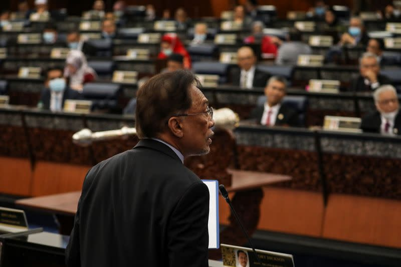 Malaysia's opposition leader Anwar Ibrahim speaks during a session of the lower house of parliament, in Kuala Lumpur