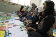 Minority Muslim Rohingya refugees attend a basic English lesson at a slum on the outskirts of Kuala Lumpur, Malaysia, on Oct. 11, 2020. Refugee women in Malaysia, some in their late 50s, are learning to read and write for the first time. The classes outside Kuala Lumpur are offered by the Women for Refugees group, which was formed in September by two law students to help illiterate migrant women integrate into the local community and empower them to be more than just passive wives. (AP Photo/Vincent Thian)