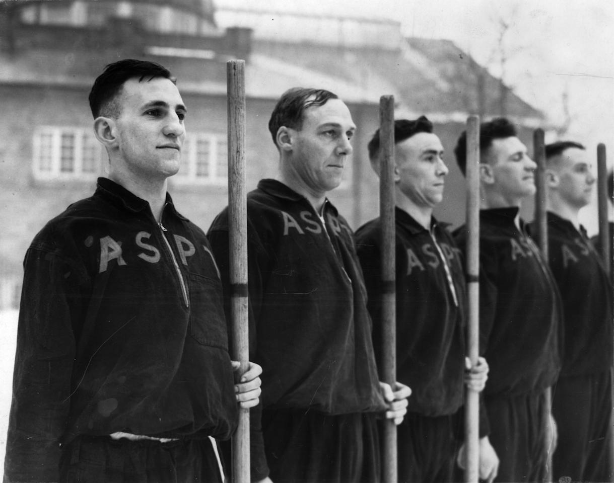 April 1940:  From left to right, England cricketers Len Hutton (1916 - 1990) and Stan Nichols on parade at an ASPT (Army School of Physical Training) during World War II. Each man carries a stout stick in his hand.  (Photo by Fred Ramage/Keystone/Getty Images)