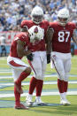 Arizona Cardinals wide receiver Christian Kirk, left, celebrates after scoring a touchdown against the Tennessee Titans in the second half of an NFL football game Sunday, Sept. 12, 2021, in Nashville, Tenn. (AP Photo/Mark Zaleski)