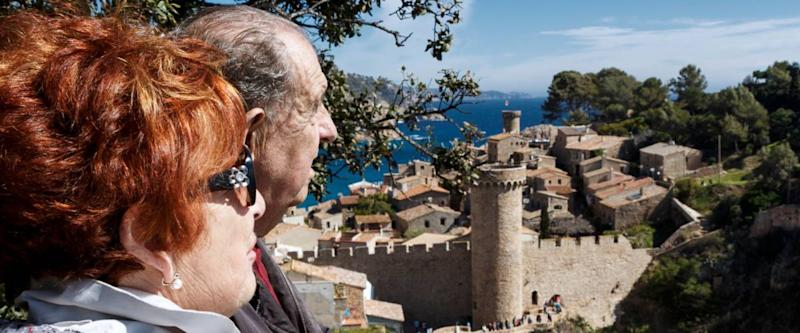 Retired couple on vacation visiting Tossa de Mar. Spain